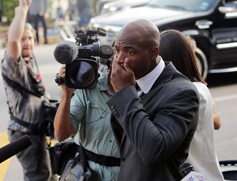 Adrian Peterson leaves the courthouse upon being reinstated after his initial suspension.