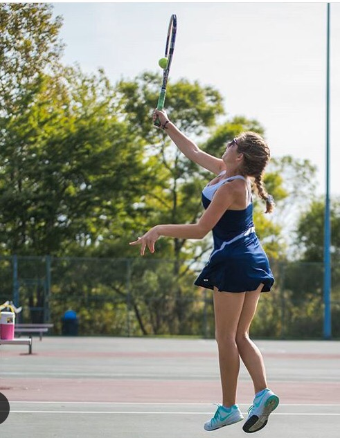 Co-Captain Lindsey Blashka on the Solon tennis Courts competing in a doubles match.