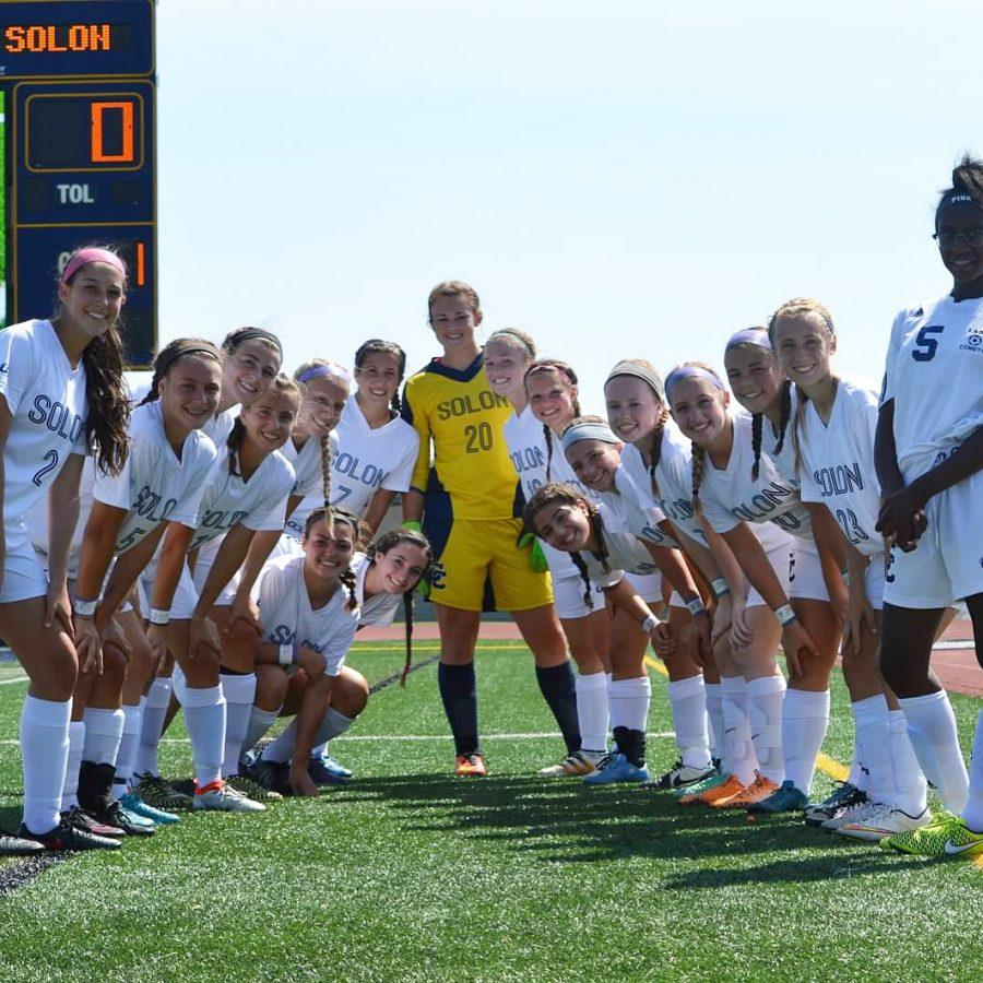 The team posed for a photo on Stewart Field.