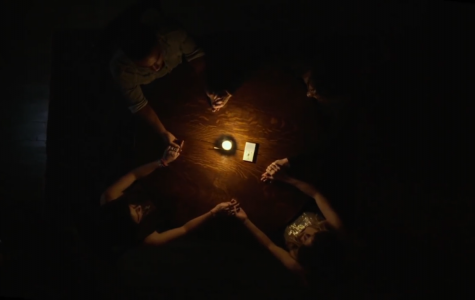 Kim, Sasha, John and Elliot hold a seance in their home.