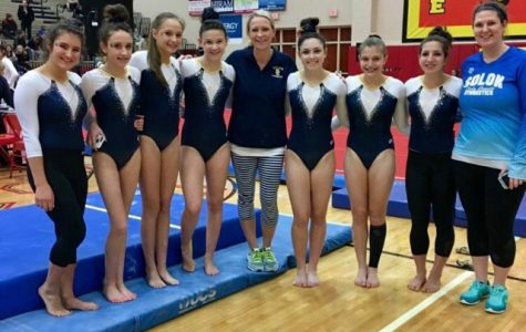 The girls gymnastic team poses after a recent meet.