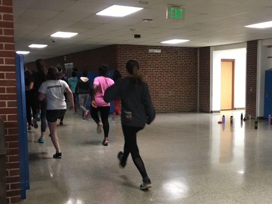 The Indoor girls track team practices on Monday and Wednesday in the halls of SHS.