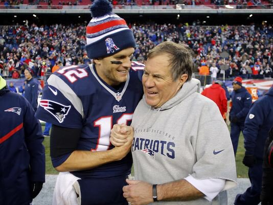 caption: Quarterback Tom Brady and head coach Bill Belichick will attempt to win their fifth ring together in Super Bowl LI.