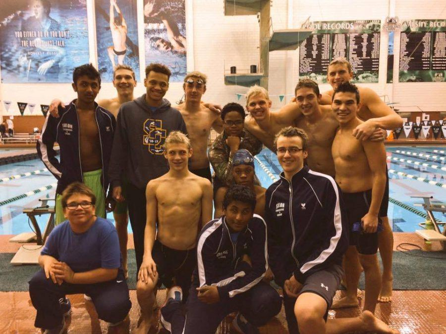 The boys swim team poses for a picture after winning their first GCC and Conference meet since 2010.