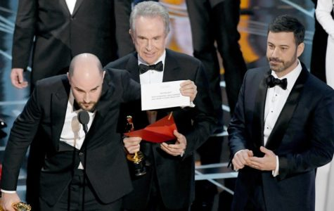 La La Land's Producer, Jordan Horowitz, clarifies the winner to the audience after snatching the correct card out of Warren Beatty's hand.