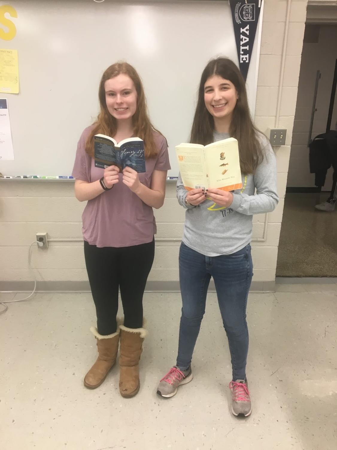 Senior Julia Mayer and junior Carly Stewart show off well-read books.