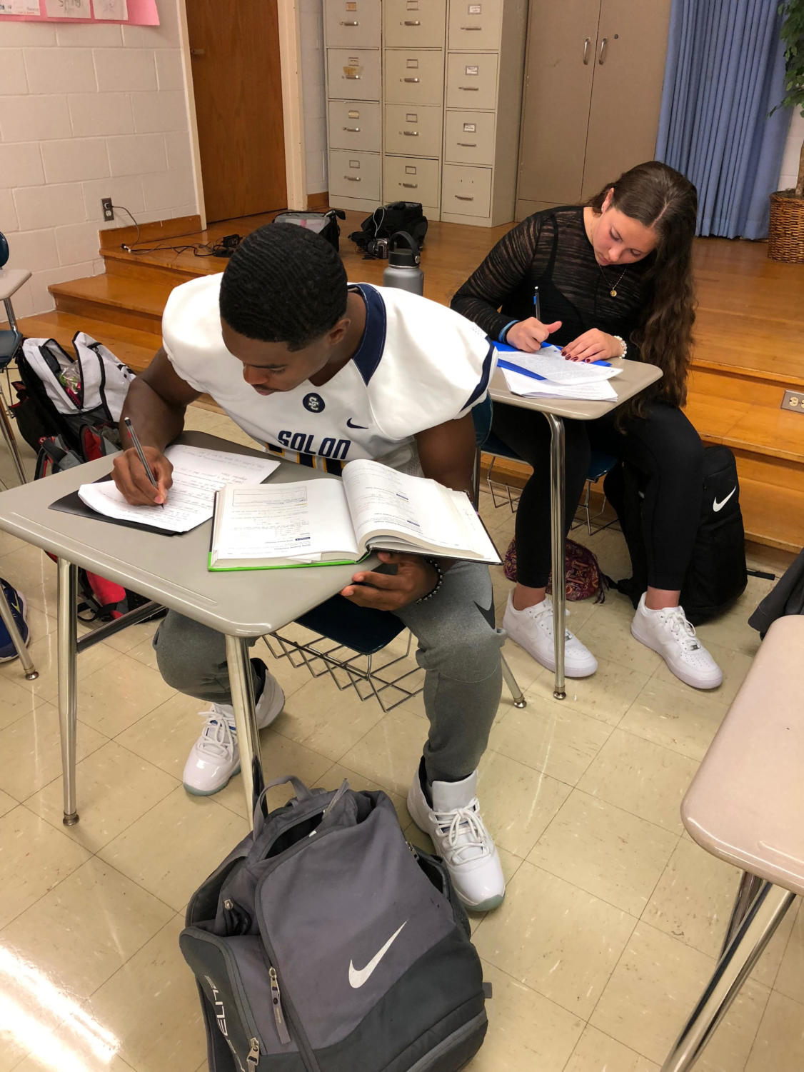 Solon High School students Kevin Perry and Skyla Caito do homework.