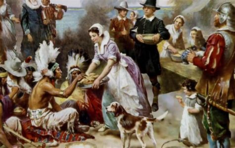The Colonists and Native Americans celebrating the first Thanksgiving.