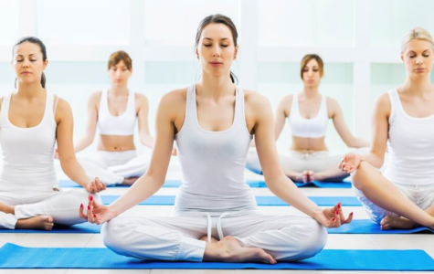 Meditation shown during yoga. Photo Credit: https://yogatrade.com/event/200-hour-hatha-yoga-teacher-training-course-in-rishikesh-india/