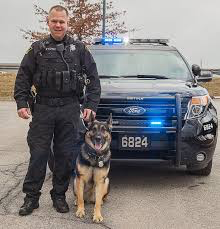 Pictured here is Stryker and Solon Police Officer Matt Troyer, both members of the canine/search unit that frequently searches SHS. Photo Credit: http://www.chagrinvalleytoday.com/communities/solon/article_a949f094-ba7e-11e3-b7ae-0017a43b2370.html