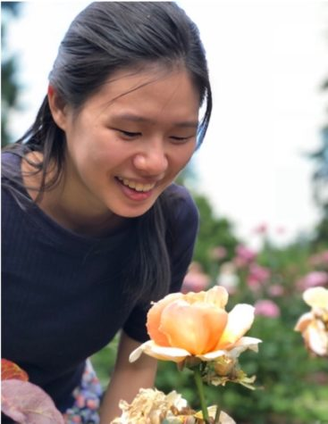 Sandy Shen smelling the flowers in Oregon over the summer. Photo taken by Katie Shen.