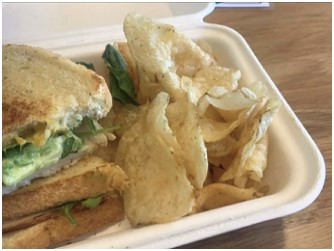 A panini sandwich and chips Baek ordered at Luna Bakery and Cafe during her lunch period