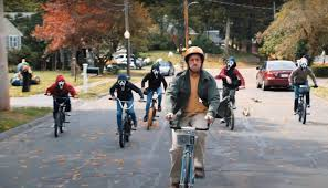 In this scene, Hubie is biking away from his young bullies