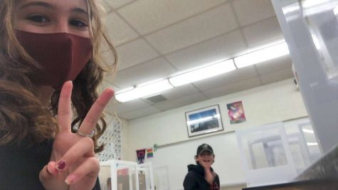 Fellow SHS freshmen Ella Giallanza and Boston Hazelwood in between classes at the school while social distancing and sitting at their desks with plastic screens.