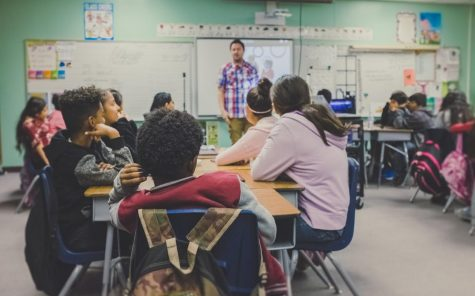 A classroom with students, courtesy of unsplash.com