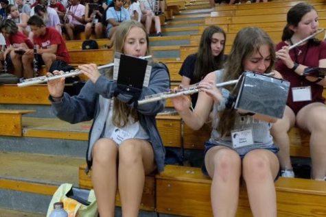 Senior flutist Nicole Ratka (left)